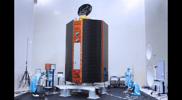 Mission team members perform acoustic tests of the Sentinel-6 Michael Freilich satellite