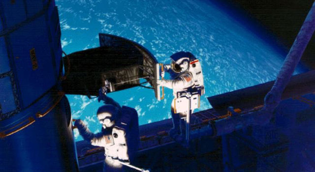 Camera installation by shuttle astronauts