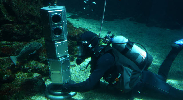 Researchers are testing an under-ice rover's systems while it is at the bottom of a large aquatic exhibit