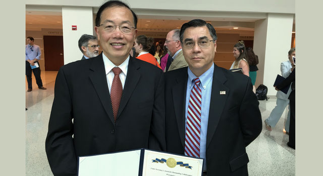 Edward Chow (left), Manager of JPL's Civil Program Office and program manager for a new artificial intelligence technology, stands with John Merrill (right).