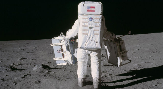 Astronaut Edwin E. Aldrin Jr. moves toward a position to deploy two components of the Early Apollo Scientific Experiments Package