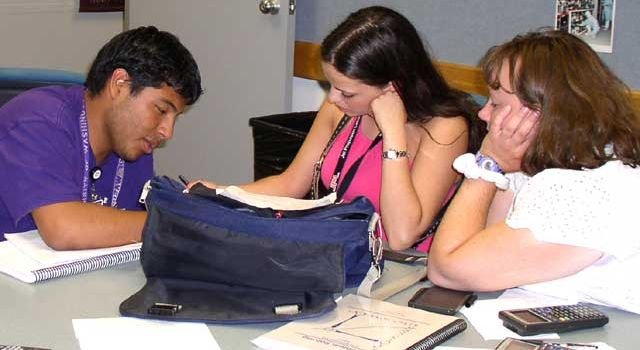 ALVA students Edgar Flores and Carolina Smith, with teacher Tracie Merrill.