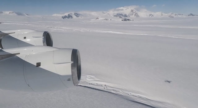 A view from Operation IceBridge's aircraft of Crosson Ice Shelf, foreground. Mt. Murphy is in the background.