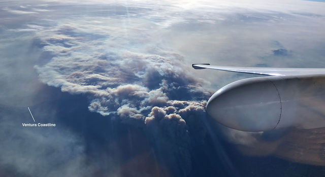 Ventura coastline is barely visible under a plume of smoke