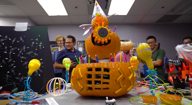 JPL Birthday/Halloween pumpkin with mechanical arms.