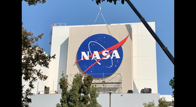 The sign, as seen from a distance, on JPL'S Spacecraft Assembly Facility