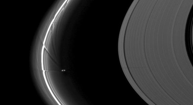 Saturn and its moon Prometheus