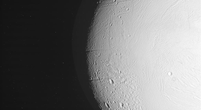 This raw, unprocessed image of Enceladus was taken on May 18, 2010, by the Cassini spacecraft, which was approximately 75,000 kilometers (46,500 miles) away at the time.