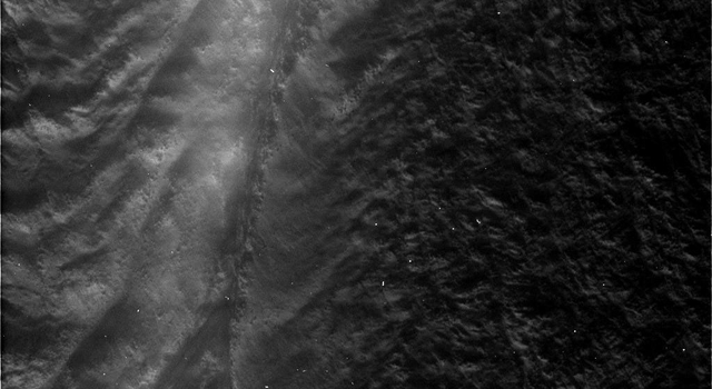 This image, taken on August 13, 2010, by NASA's Cassini spacecraft, shows the fissure on the surface of Saturn's moon Enceladus known as Damascus Sulcus.