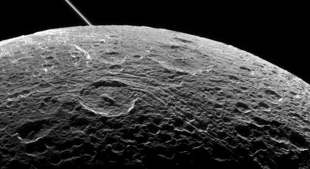A view of Saturn's moon Dione captured by NASA's Cassini spacecraft during a close flyby on June 16