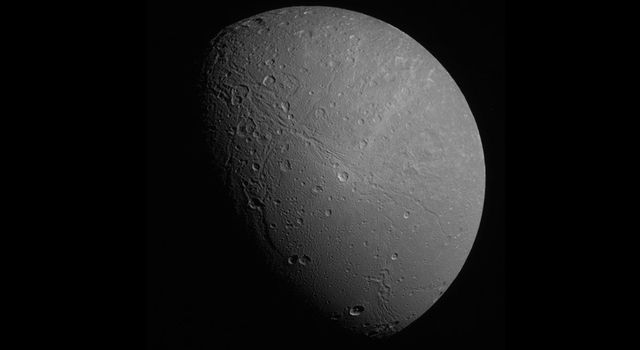 Half-phase Dione in Approximate True Color by Emily Lakdawalla.