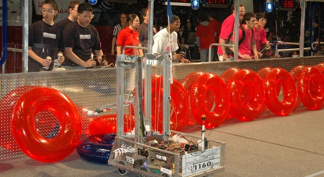student and their robots compete