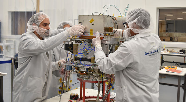 Technicians working on the atomic clock
