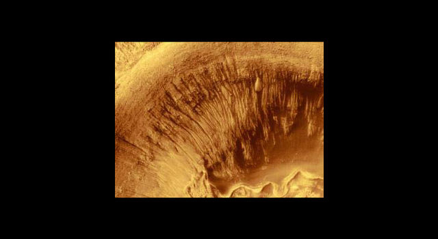 Evidence of ancient liquid water flows on Mars, imaged by Mars Global Surveyor