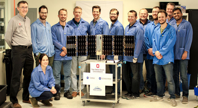 The CubeRRT satellite and Blue Canyon Technologies team members with Principal Investigator Joel Johnson (far left) of The Ohio State University.