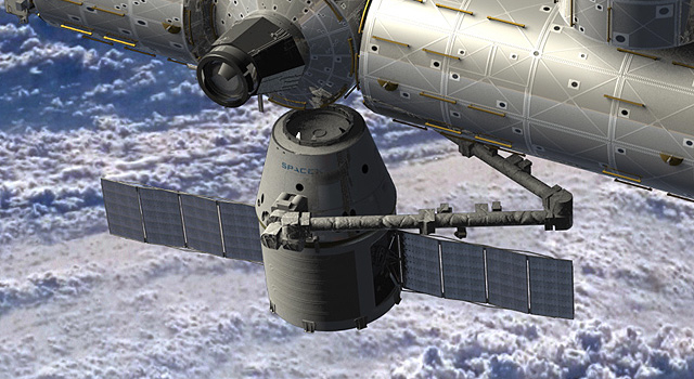 Artist's rendering of a SpaceX Dragon spacecraft being berthed to the International Space Station.