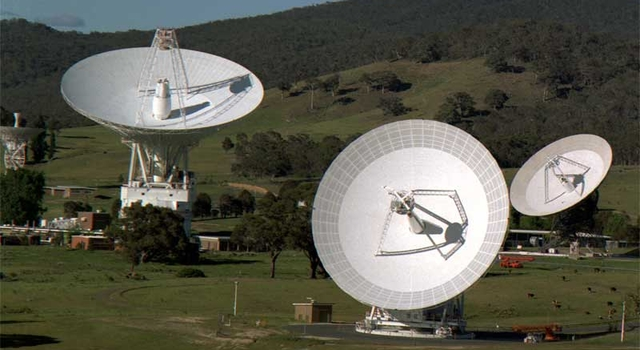 View of the Canberra Complex showing the 70m (230 ft.) antenna and the 34m (110 ft.) antennas.