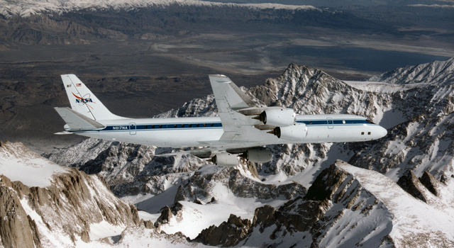 NASA's DC-8 airborne science laboratory soars over the Pinnacles near Mount Whitney, Calif., during a checkout flight in the  winter of 1998.