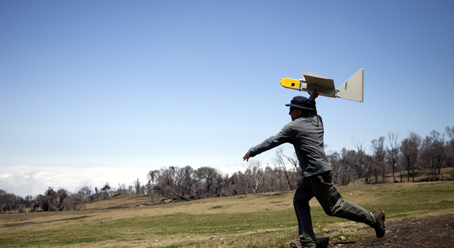 Ames research scientist Rick Kolyer launches Dragon Eye UAV.