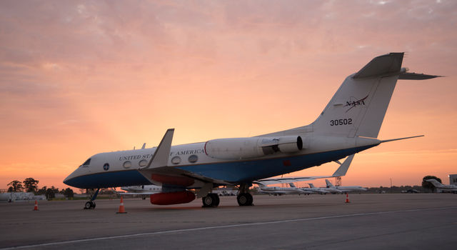 The sun rises on NASA's C-20A as it sits at Louis Armstrong New Orleans