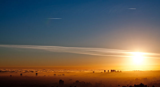 Cuts in ground-level, ozone-forming pollutants are cleansing the West Coast's cloud-and-smog mix