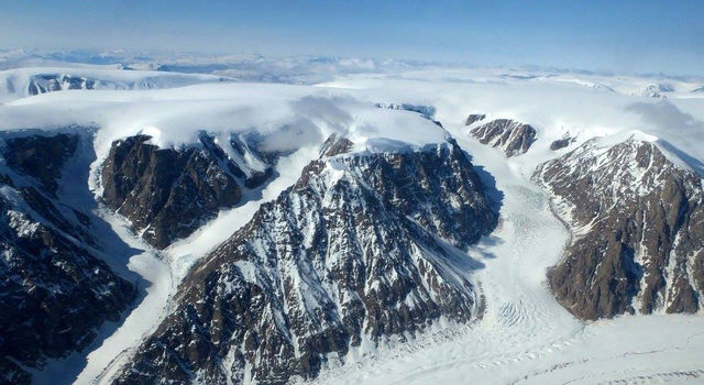 The Greenland Ice sheet discharging into valleys.