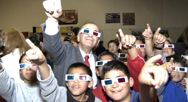 Dr. Charles Elachi and students wear 3-D glasses