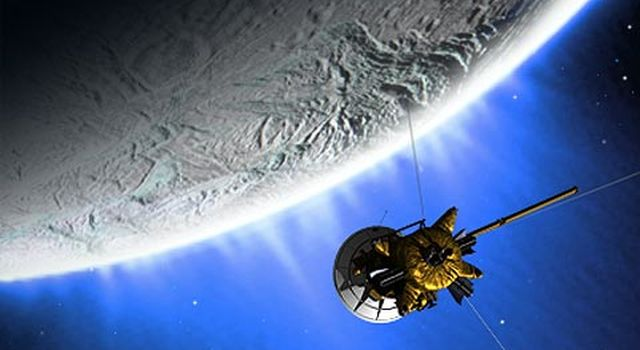 This is an artist concept of Cassini flying past Enceladus.