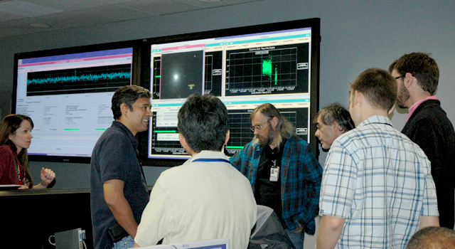 EPOXI navigation team members and engineers in mission control at JPL