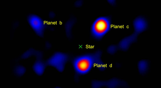 This image shows the light from three planets orbiting a star 120 light-years away
