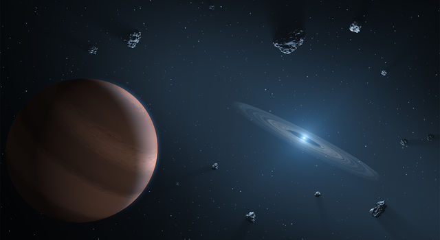 Artist concept of an exoplanet and debris disk orbiting a polluted white dwarf. Credit: NASA/JPL-Caltech