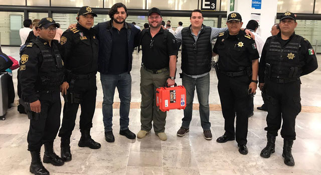 Troy Hubschmitt, product manager at SpecOps Group, Inc. (center) stands with other members of SpecOps Group and Mexican state police