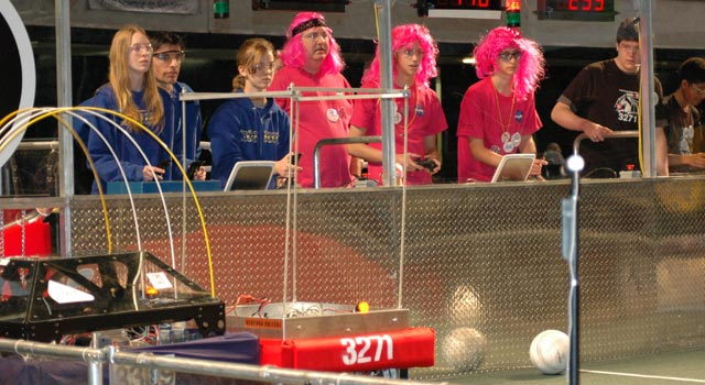 Image of the teams are operating their robots remotely