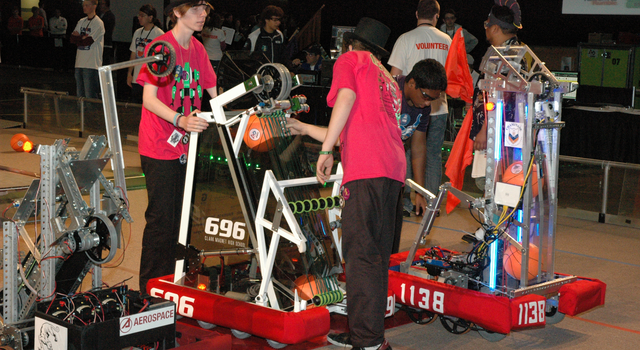 Students inspect and prepare their robot for competition.