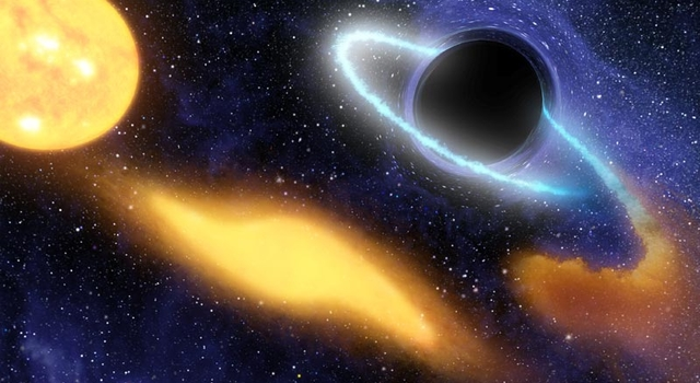 artist's concept shows a supermassive black hole at the center of a remote galaxy digesting the remnants of a star