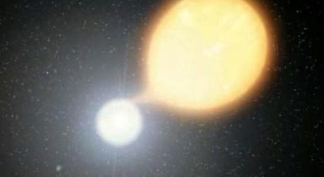 artist concept showing white dwarf sucking matter from companion star