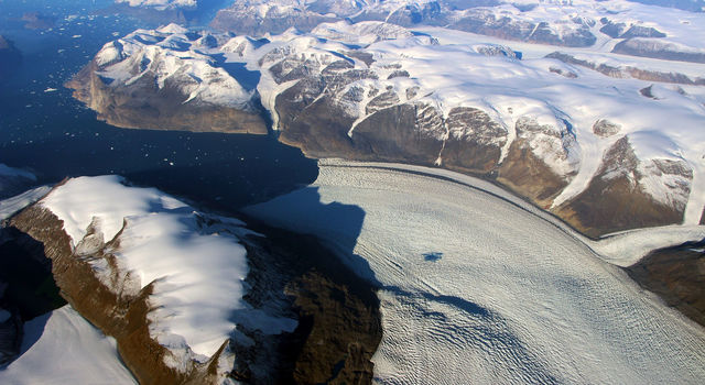 Rink Glacier in western Greenland, with a meltwater lake visible center.