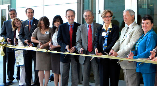 Charles Elachi and other dignitaries cut the ribbon for JPL's Flight Projects Center