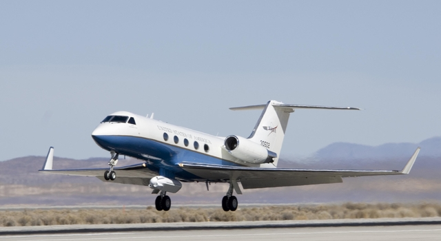 NASA's Gulfstream-III research test bed lifts off from the Edwards Air Force Base runway with the UAVSAR pod under its belly.