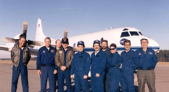 Helen Worden and team in front of a plane