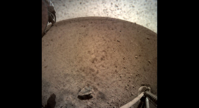 NASA's InSight spacecraft popped the lens cover off its Instrument Context Camera (ICC) on Nov. 30, 2018