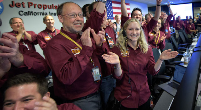 Bruce Banerdt, InSight Principal Investigator, NASA JPL, left, Hallie Gengl, Data Visualization Developer, NASA JPL, right, and other NASA InSight team members celebrate