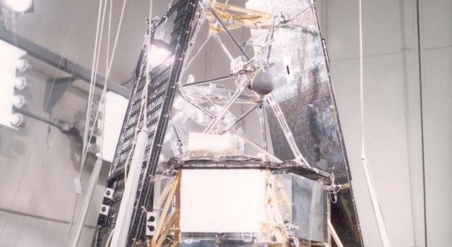 A Mariner 2 team member gives a final check to the Mariner 2 spacecraft in one of the highbays