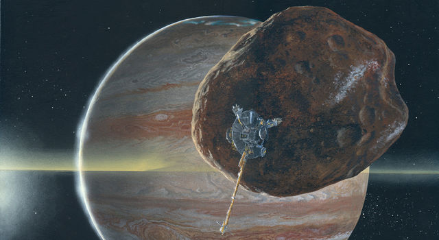 Artist's concept of Galileo passing near Jupiter's small inner moon Amalthea.
