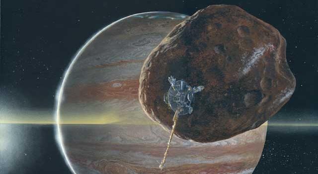 Artist's concept of Galileo passing near Jupiter's small inner moon Amalthea. Image credit: Michael Carroll