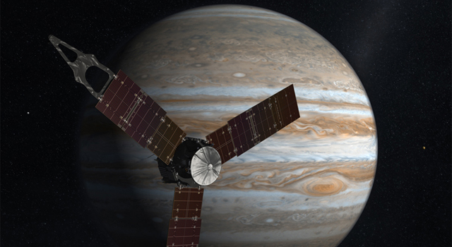 NASA's Juno spacecraft passes in front of Jupiter in this artist's depiction.