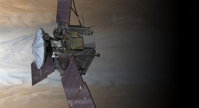 NASA's Juno spacecraft is shown in orbit above Jupiter's colorful clouds in this artist's rendering.