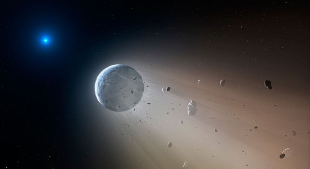 In this artist's conception, a tiny rocky object vaporizes as it orbits a white dwarf star.