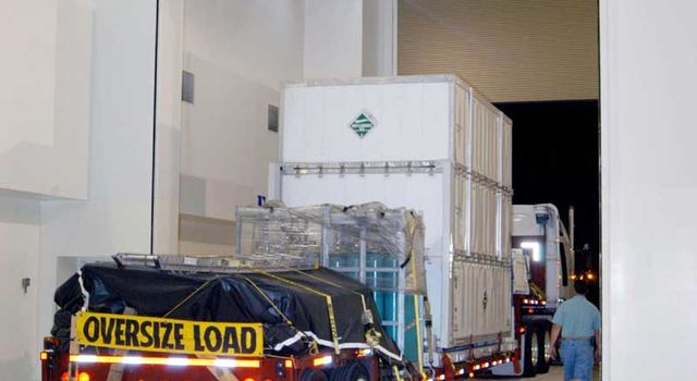 truck carrying Deep Impact arrives at facility