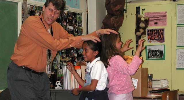 Coordinator of JPL Daze at LA's Best, Richard Shope demonstrates an effect of gravity